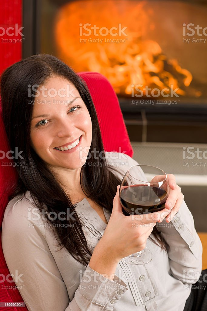Winter home fireplace woman glass red wine royalty-free stock photo