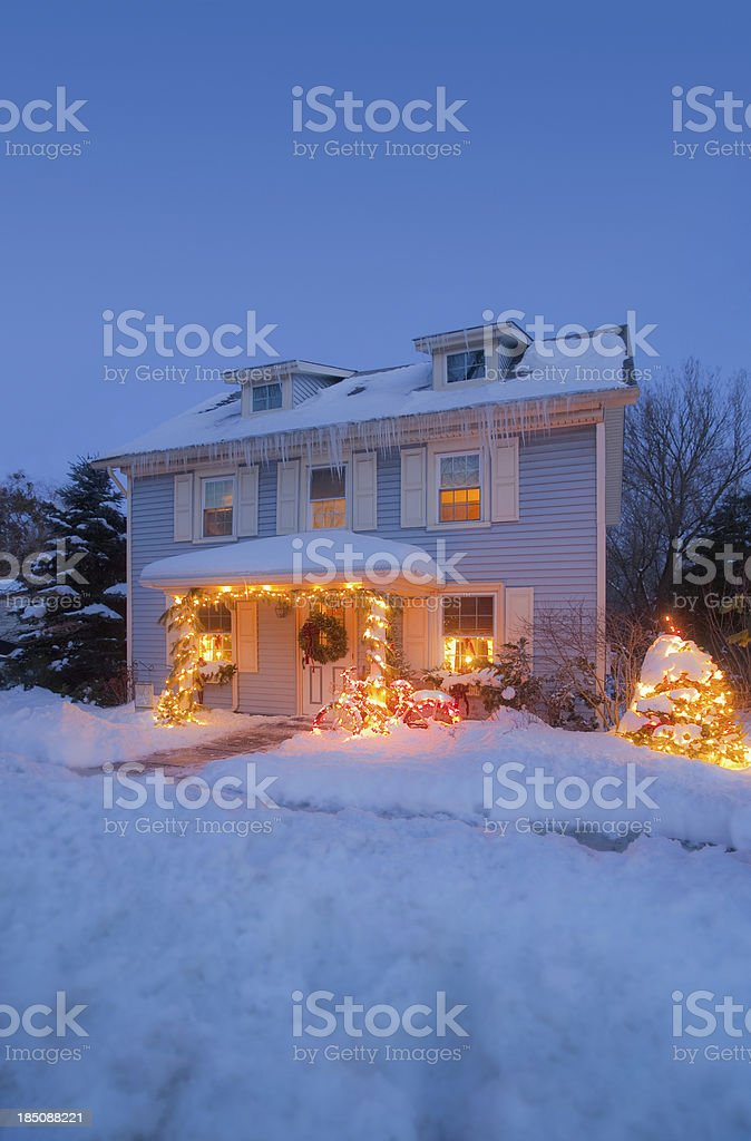 Winter house decorated with Christmas Lights stock photo