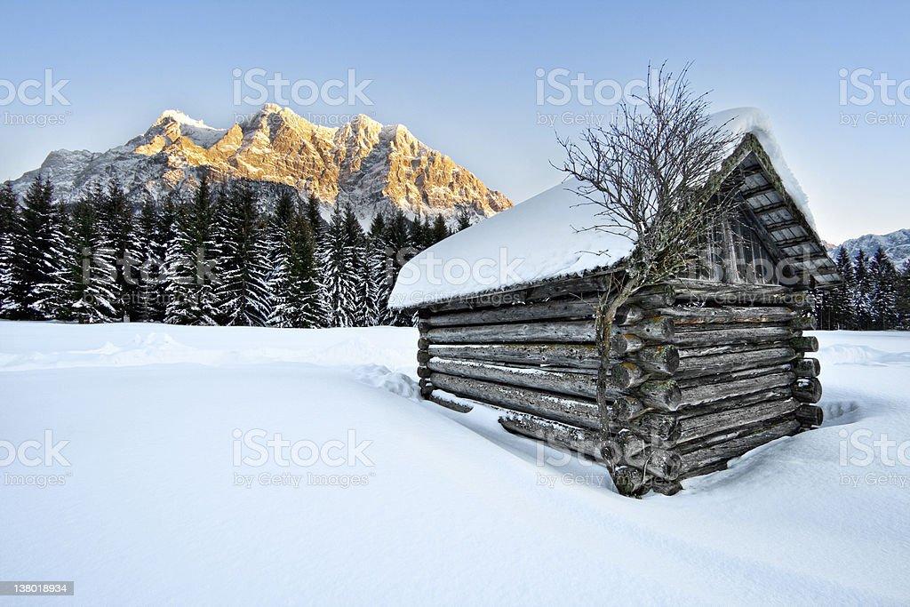 Winter Hut with Mt. Zugspitze stock photo
