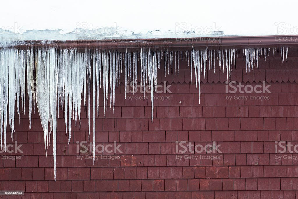 Winter Ice Dam, Icicles Forming on Roof and Gutter royalty-free stock photo