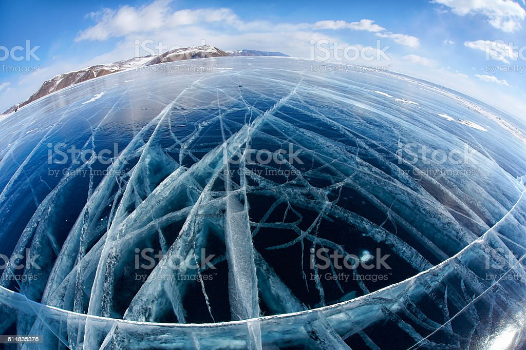 Winter ice landscape on Siberian lake Baikal with clouds stock photo