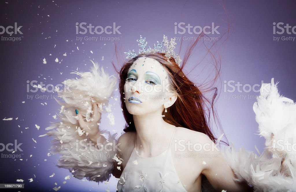 Winter: ice queen with white feathers, crystals and snowflakes stock photo