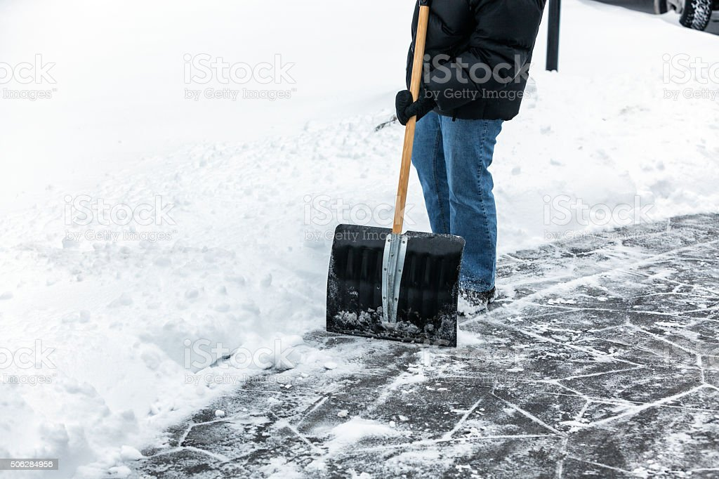 Winter Jacket Person Shoveling Sidewalk Snow stock photo