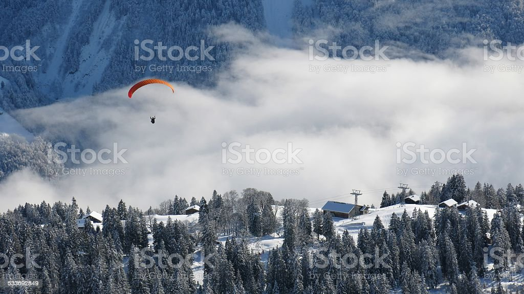 Winter landscape and paraglider stock photo