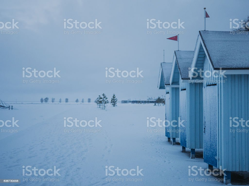 Winter landscape at beach with huts stock photo