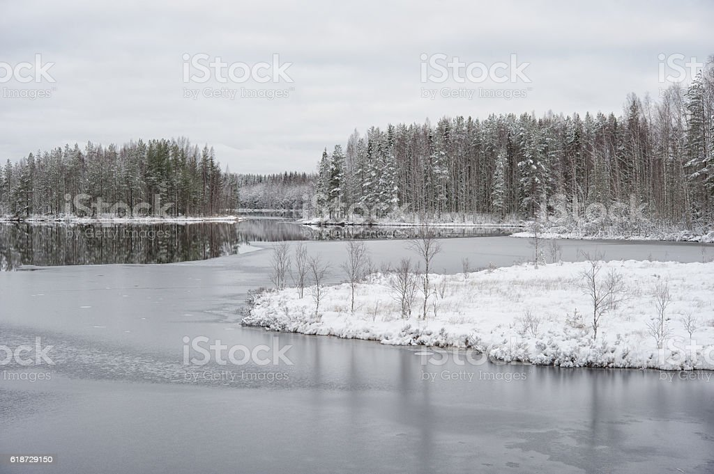Winter landscape at the lake shore stock photo
