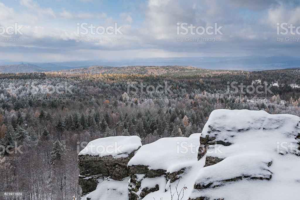 Winter landscape at with rocks under snow stock photo
