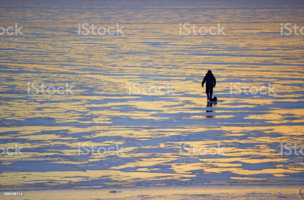 winter landscape fisherman on the river stock photo
