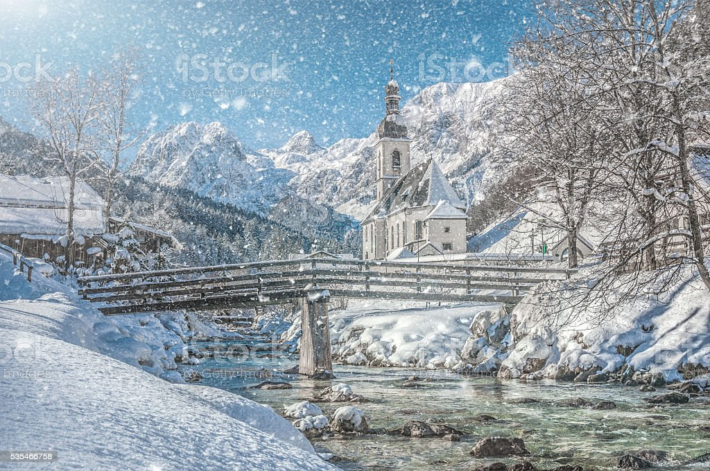 Winter landscape in the Bavarian Alps with church, Ramsau, Germany stock photo