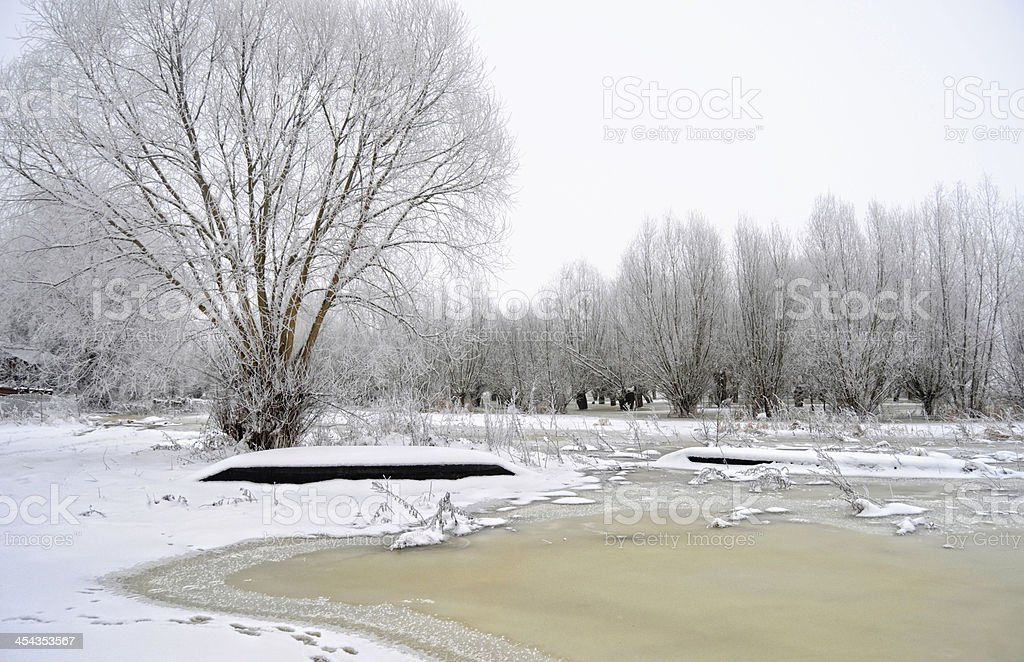 winter landscape of a river with boat stock photo