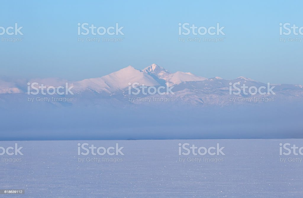 Winter Landscape of Longs Peak Mountain with snow and fog stock photo