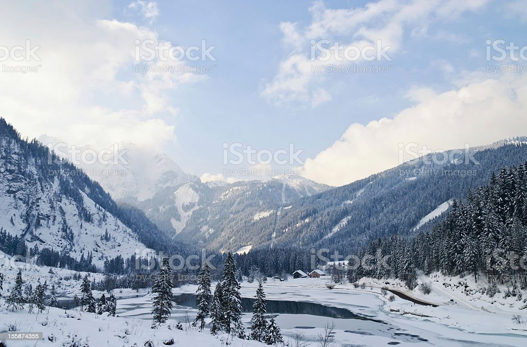 Winter landscape of the Austrian Alps and Gosau bank dam royalty-free stock photo