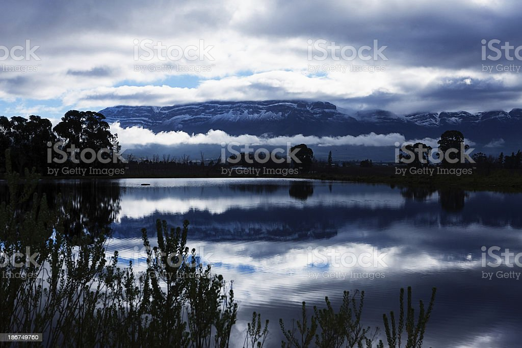 Winter landscape over clouded lake to snowclad Cape mountain range. royalty-free stock photo