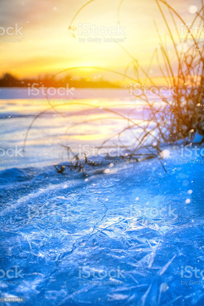 winter landscape panorama; sunset on the frozen river; stock photo