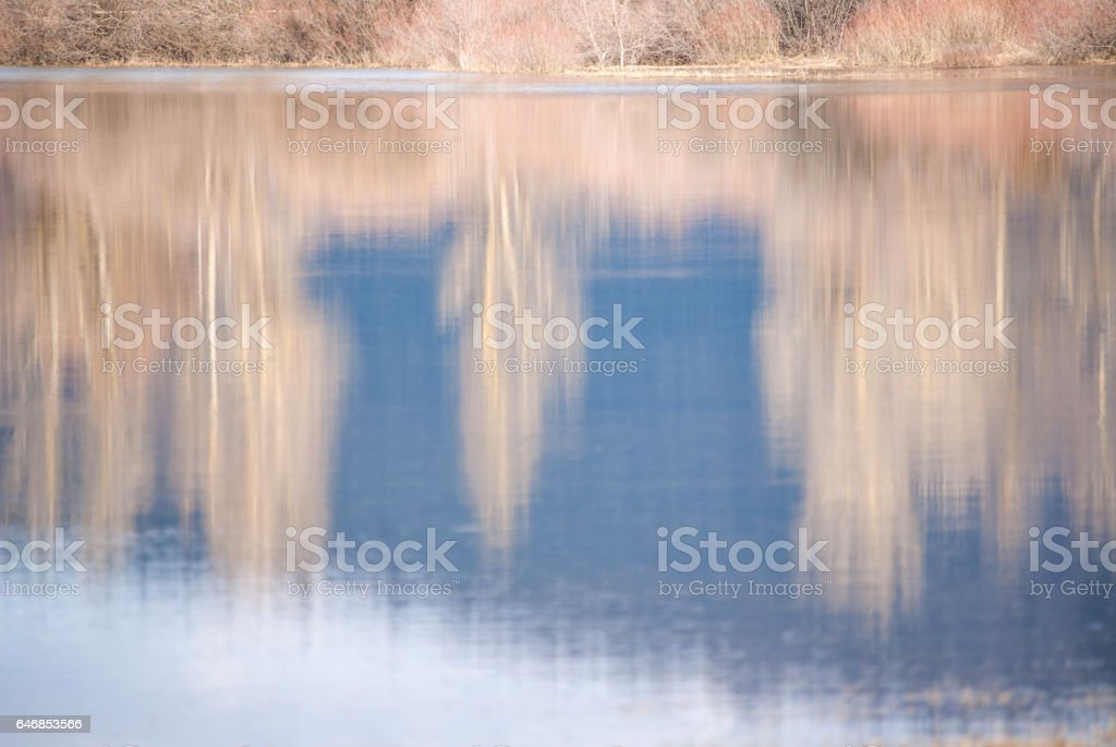 Winter Landscape Reflecting in Lake stock photo