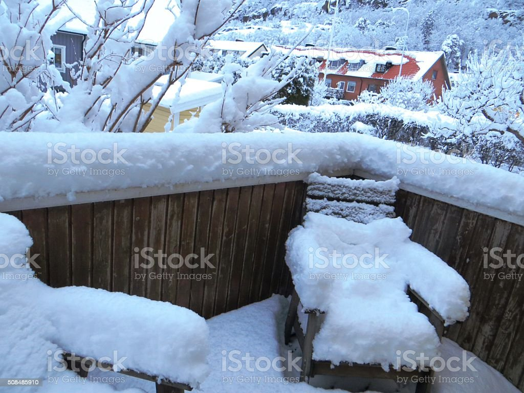 Winter landscape snowy chairs on the balcony stock photo