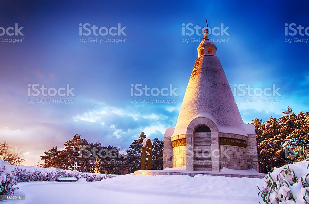 winter landscape with a chapel at dawn stock photo