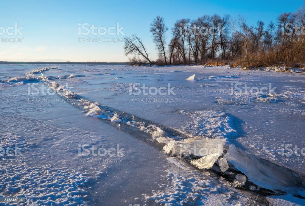 Winter landscape with frozen lake and trees. Composition of nature. stock photo