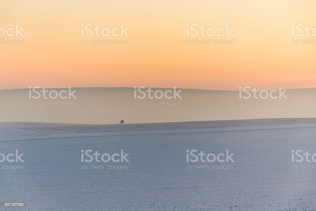 winter landscape with high seat and sunset stock photo