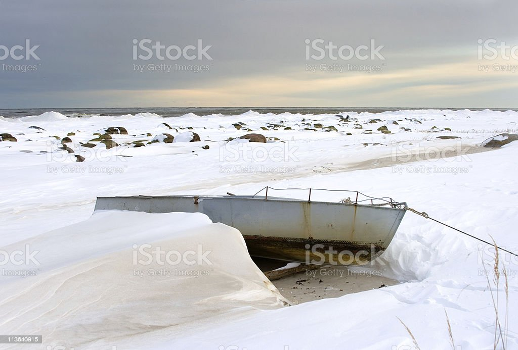 Winter landscape with lonely boat royalty-free stock photo