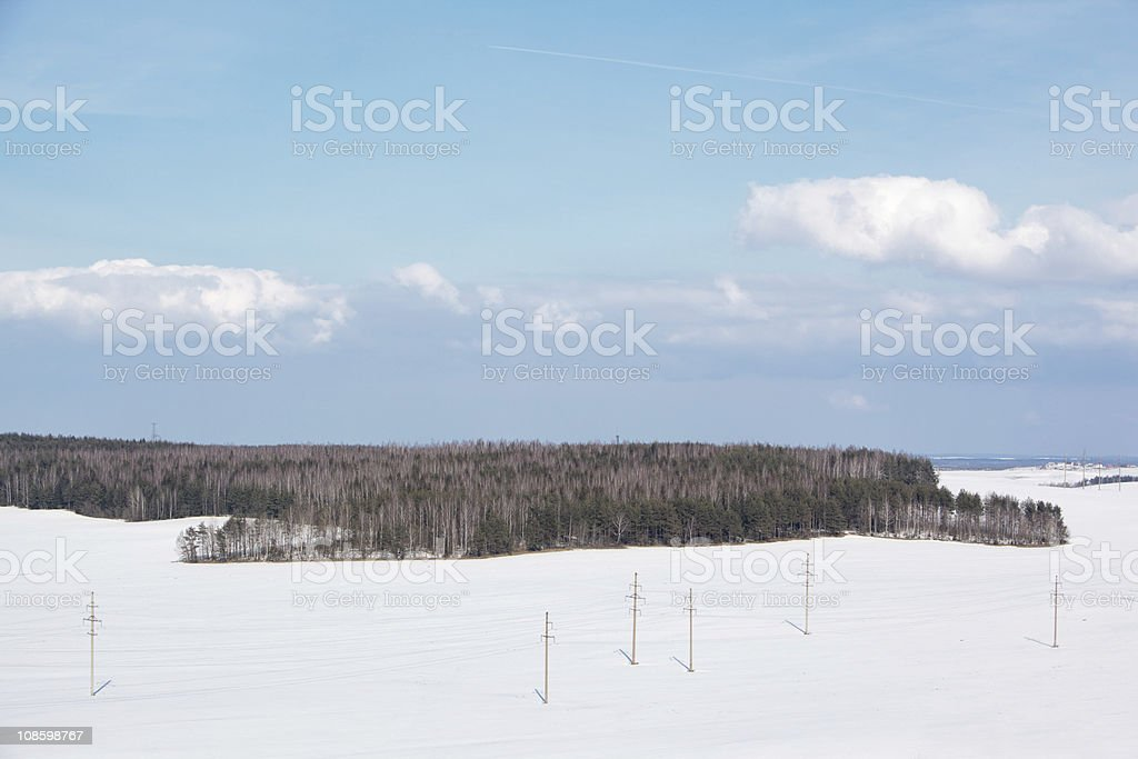 Winter landscape with power line stock photo