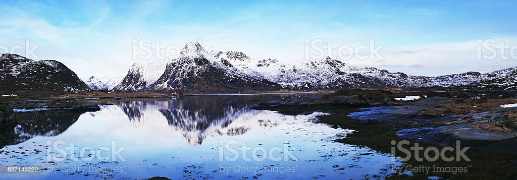 Winter landscape with reflection on Lofoten Islands near Svolvaer, Norway stock photo
