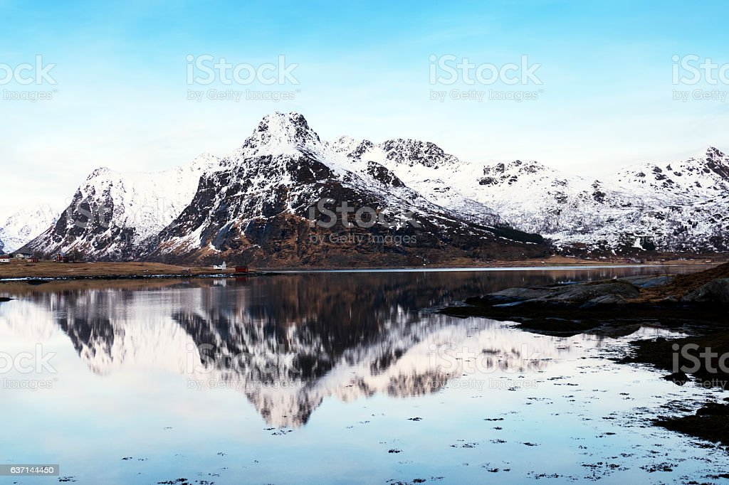 Winter landscape with reflection on Lofoten near Svolvaer, Norway - stock photo