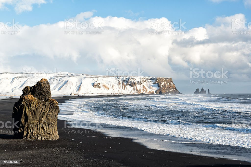 Winter landscape with Reynisdrangar stacks, black sand beach, Iceland stock photo