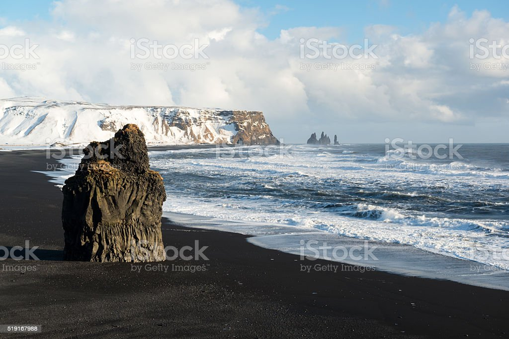 Winter landscape with Reynisdrangar stacks, black sand beach, ocean, Iceland stock photo