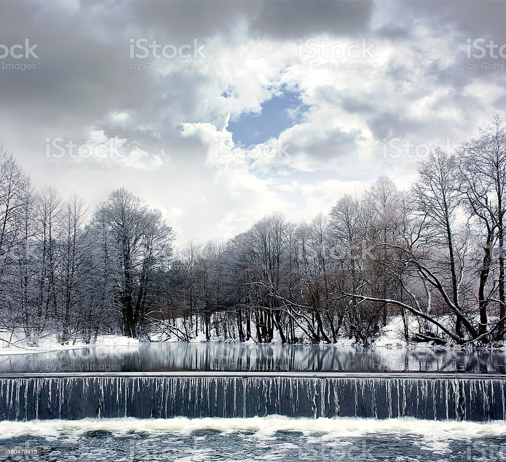 Winter Landscape with River, Waterfall and Clouds royalty-free stock photo