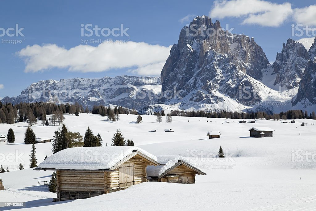 Winter landscape with shed and Langkofel mountain in Dolomites, Italy stock photo