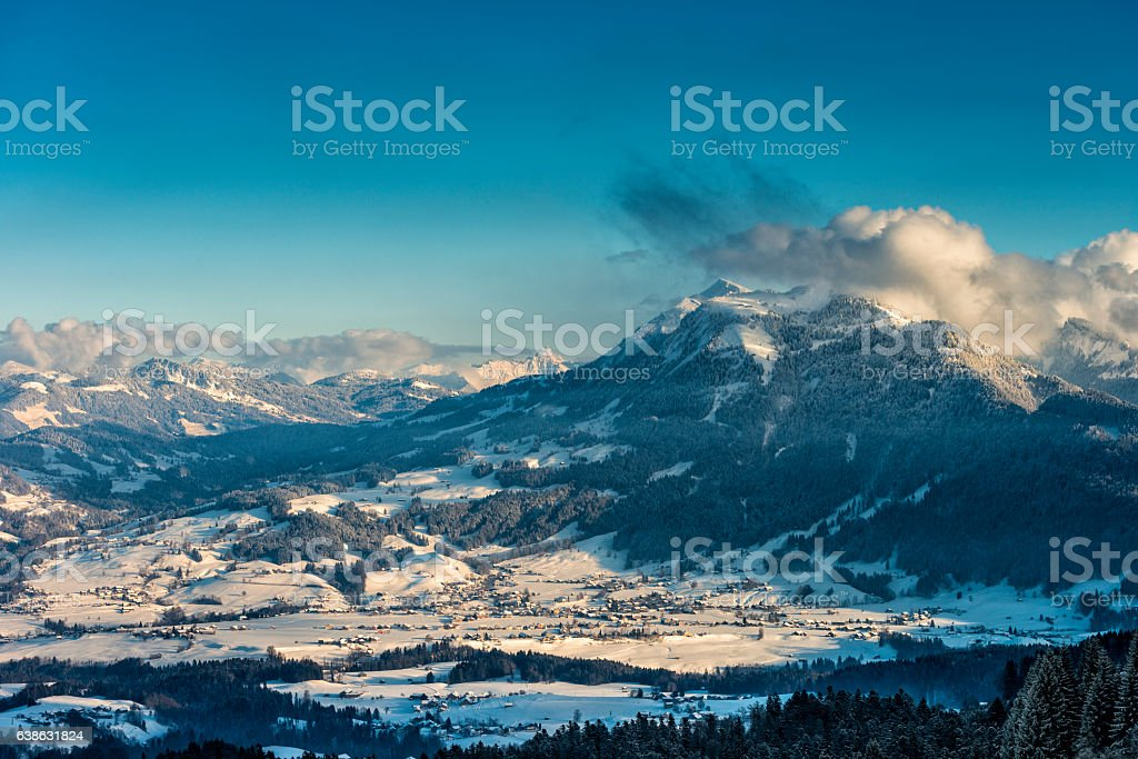 winter landscape with small village and mountains stock photo