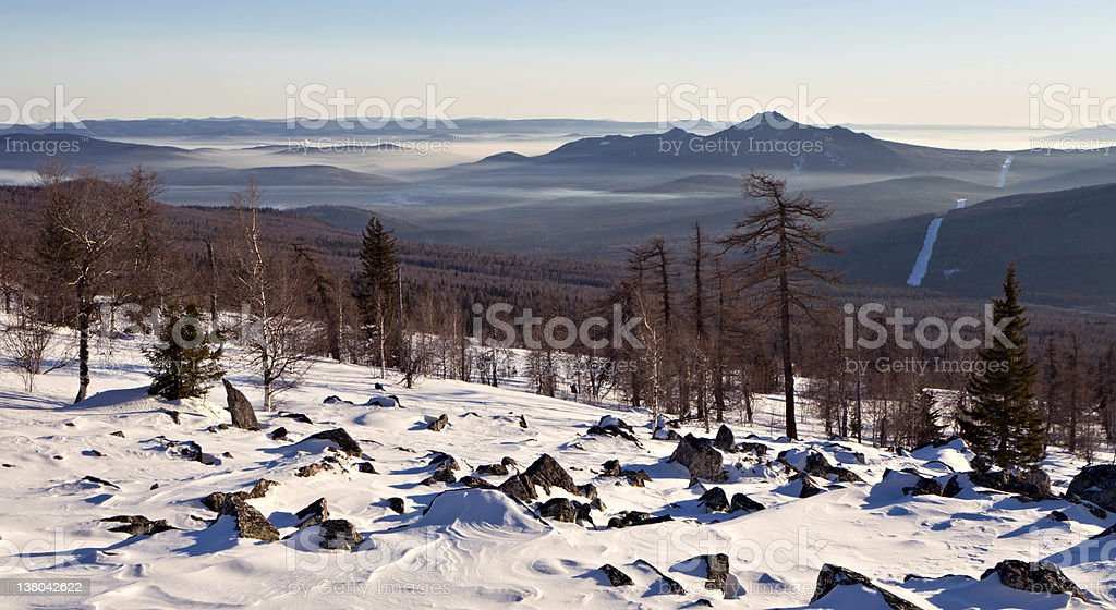 Winter landscape with stones and mountain royalty-free stock photo