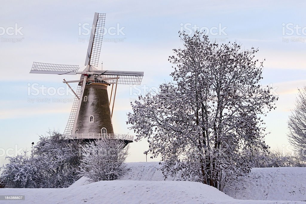 Winter landscape with windmill stock photo