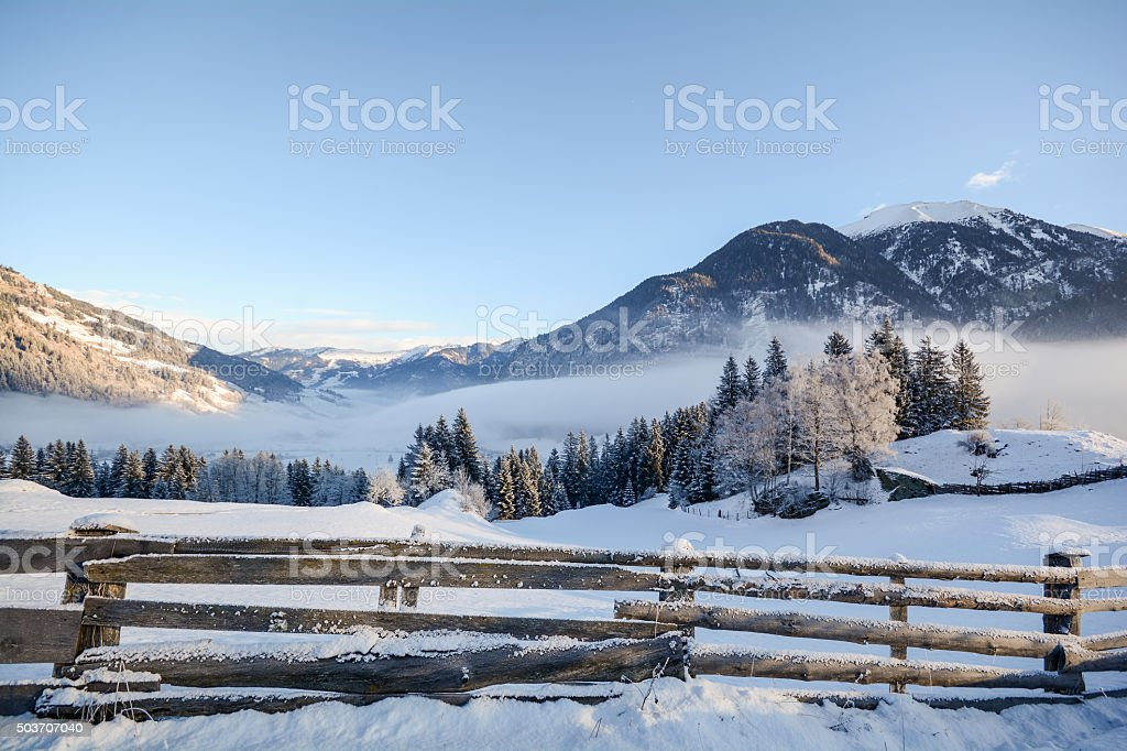 Winter landscape with wooden fence Pongau Alps - Salzburg Austria stock photo