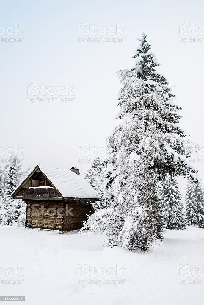 Winter Landscape with Wooden Hut royalty-free stock photo