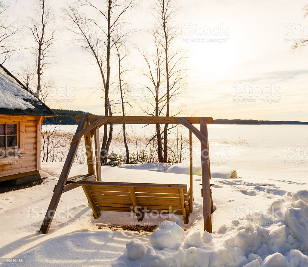Winter landscape with wooden swing stock photo