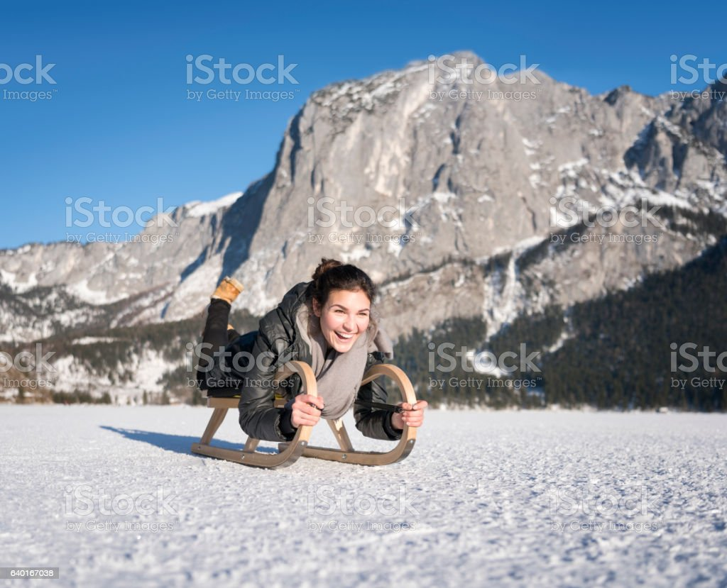 Winter Lifestyle, Beauty on a wooden Sled, Frozen Lake stock photo