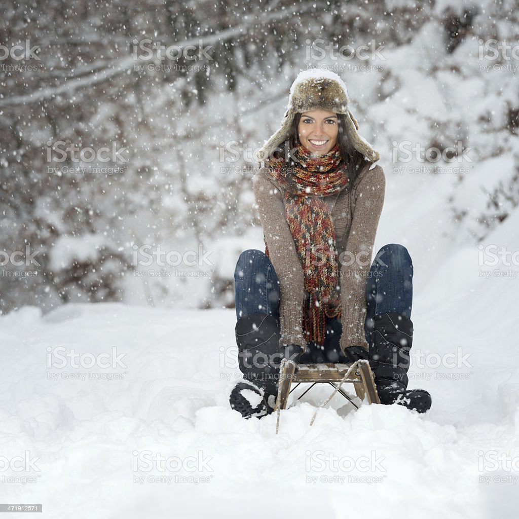 Winter Lifestyle, Beauty on a wooden Sled stock photo