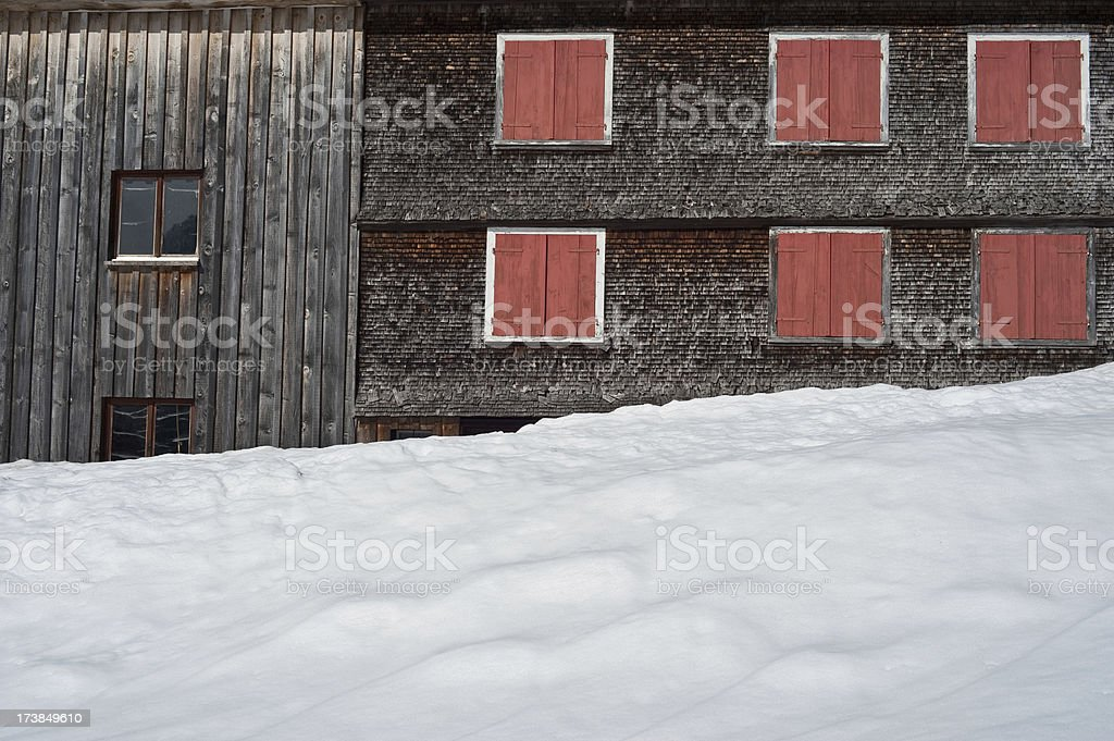 Winter lodge with red shutters stock photo