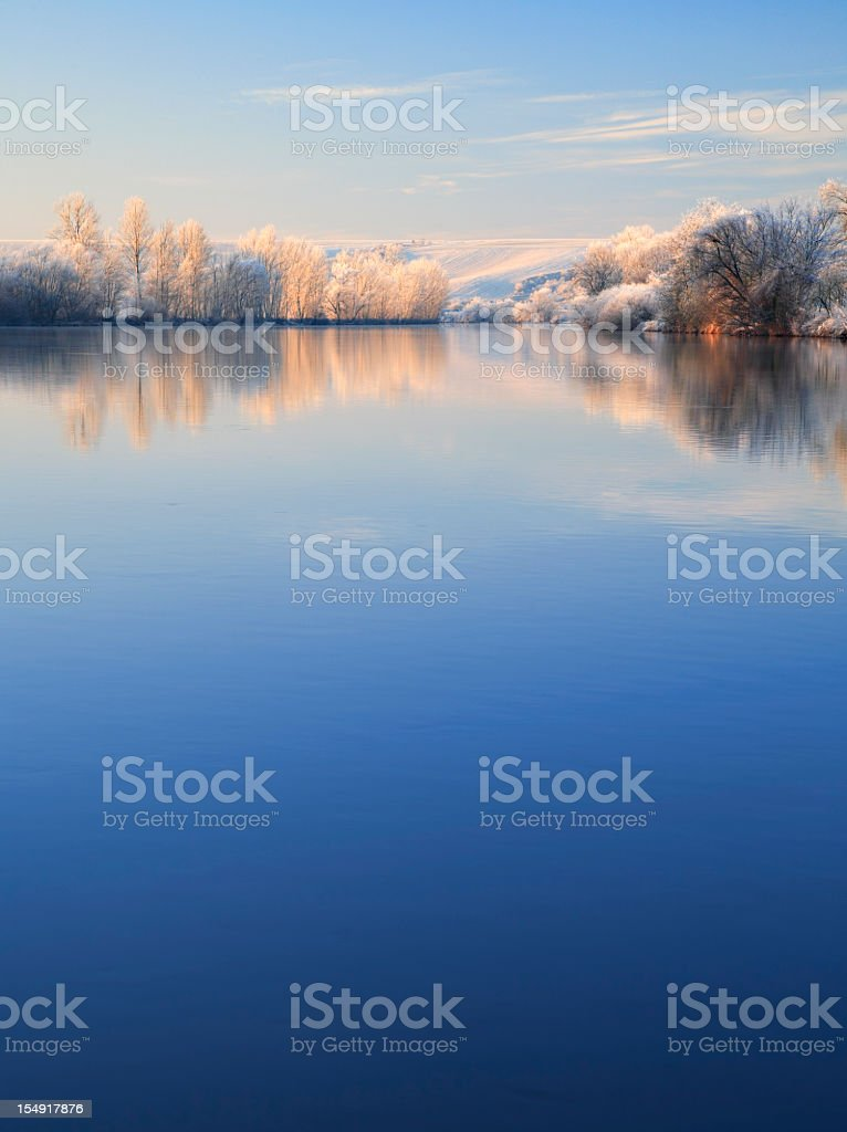 Winter Morning, Frost Covered Trees and Landscape Along River royalty-free stock photo