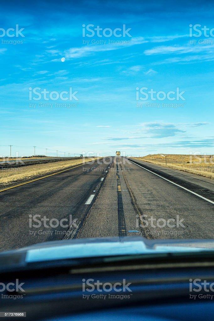 Winter Morning Moon and Straight Expressway - Wyoming USA stock photo