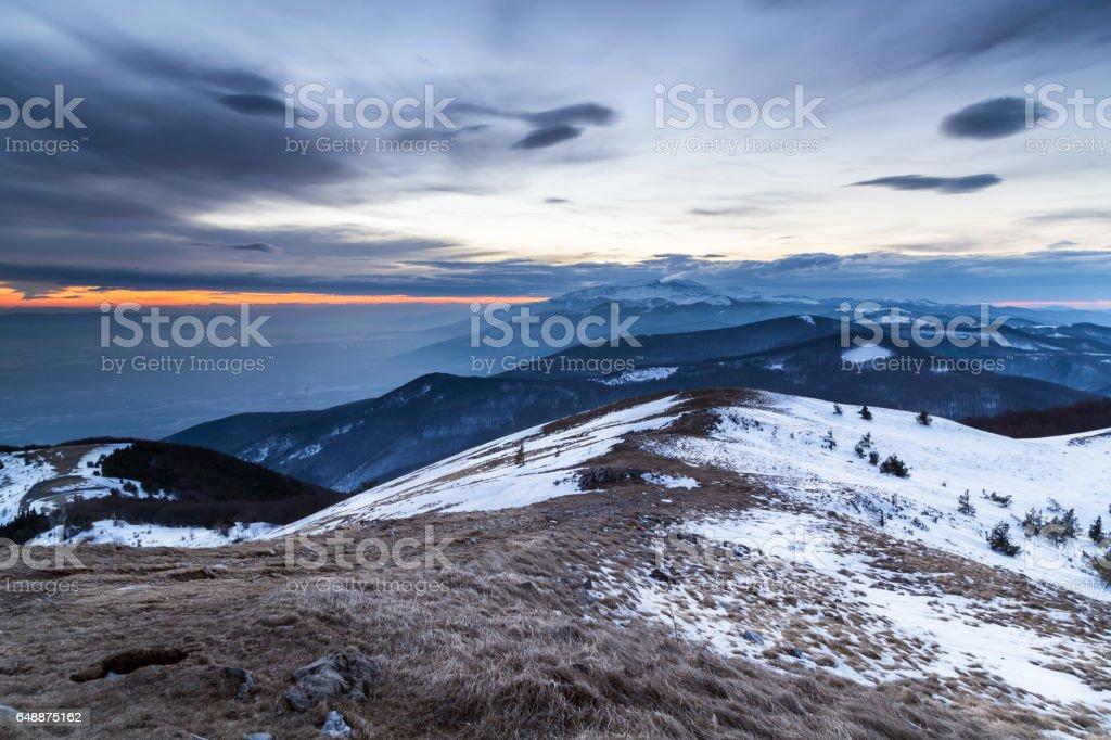 Winter mountain at sunset stock photo