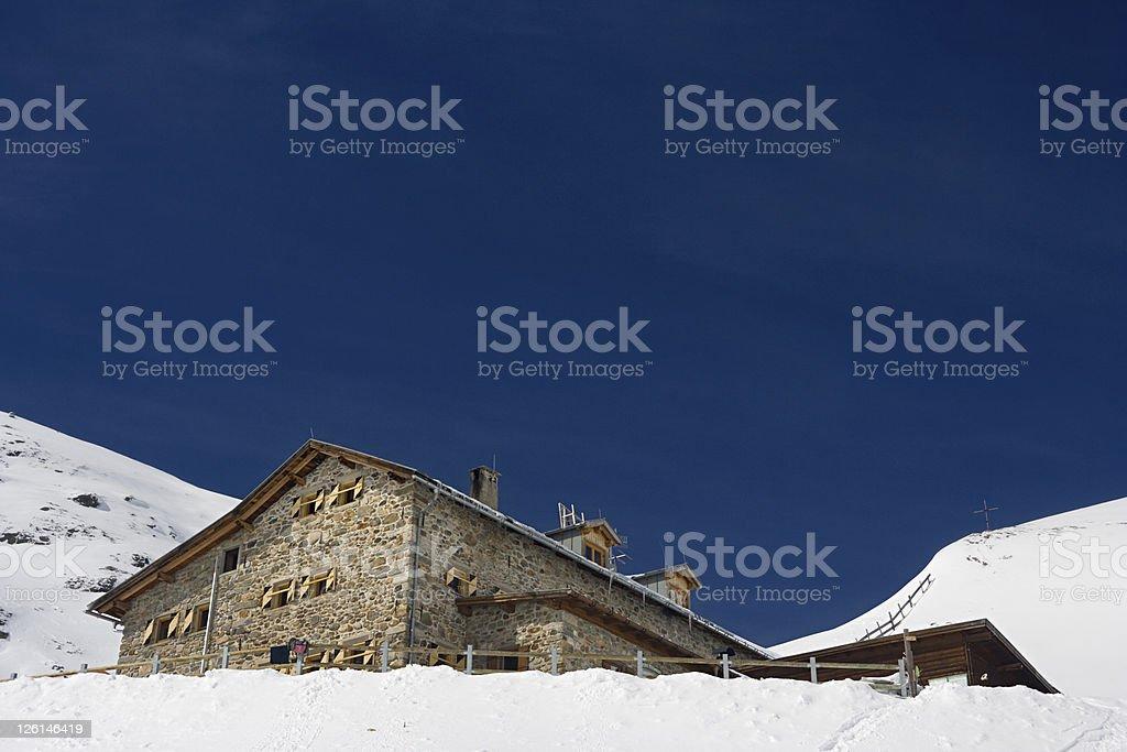 Winter Mountain Hut stock photo