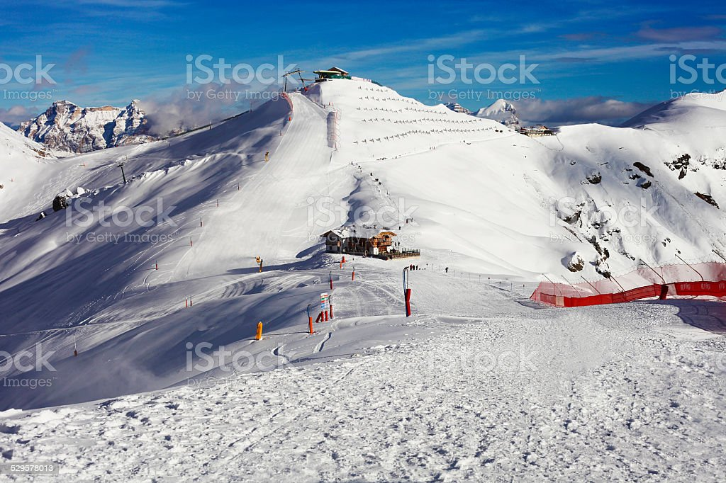 Winter mountain landscape and ski machinery in Trentino stock photo