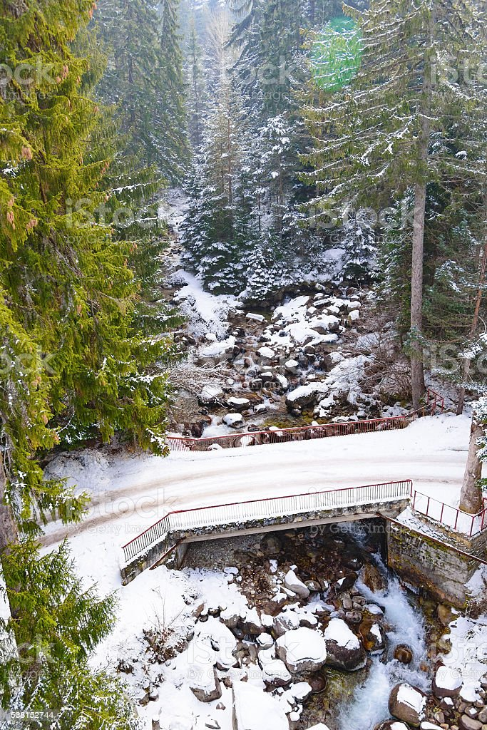 Winter mountain river bridge stock photo