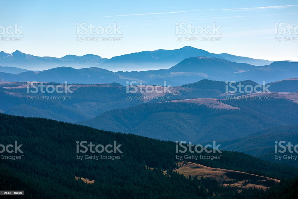 Winter Mountain View with Foggy Remote Ridges stock photo