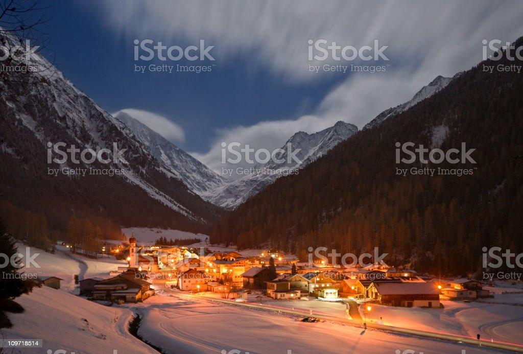 Winter Mountain Village At Night stock photo