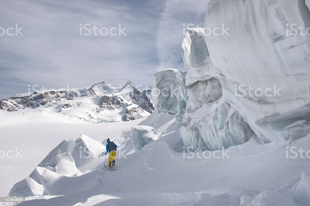 Winter mountaineering in wilderness area stock photo