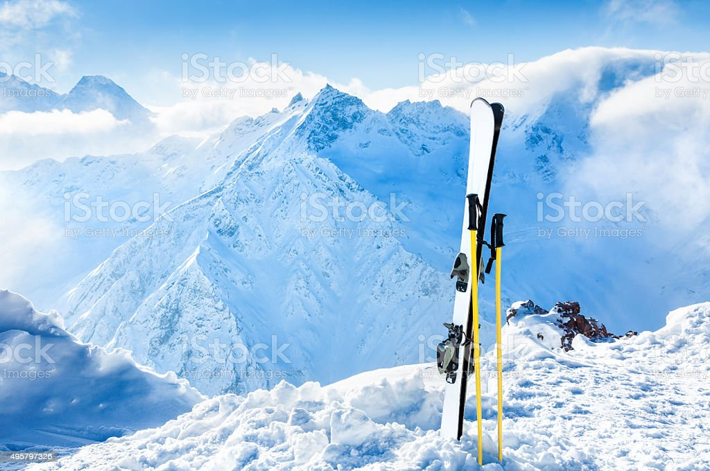 Winter mountains and ski equipment in the snow stock photo